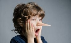 Boy in shock as his nose has grown like Pinocchio's