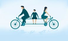 bike_riding_parents_going_opposite_directions_child_in_middle_72533647_thumbnail.jpg