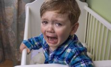 boy_little_crying_in_cot_iStock_66288077_SMALLER.jpg