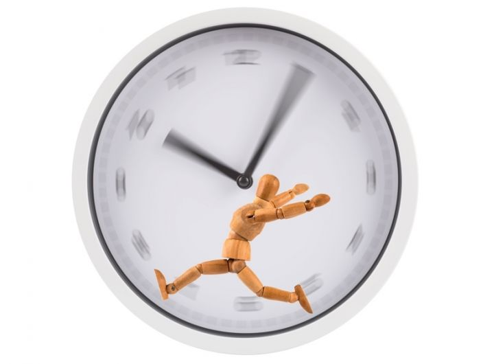 figure running on a hamster-wheel type blurry clockface